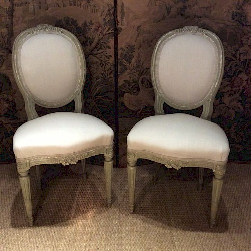 A Pair of Upholstered French Antique Chairs